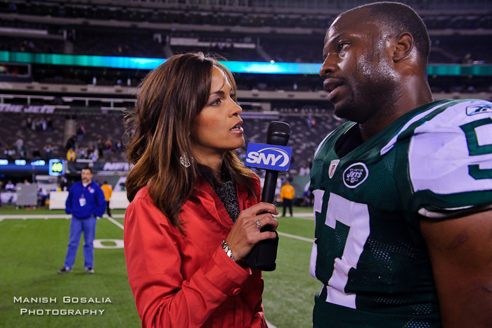 Oct 17, 2011; East Rutherford NJ, USA; SNY reporter Jeane Coakley  (left) interviews New York Jet's  linebacker Bart Scott (57) after the game against the Miami Dolphins at Metlife Stadium. The Jets defeated the Dolphins 24-6. Photo by Manish Gosalia/JetsInsider.com
