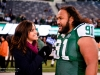Dec 11, 2011; East Rutherford, NJ, USA; SNY reporter Jeane Coakley (left) interviews New York Jet's Nose Tackle Sione Pouha (91) after the game against the Kansas City Chiefs at Metlife Stadium. The Jets defeated the Chiefs 37-10 Photo by Manish Gosalia